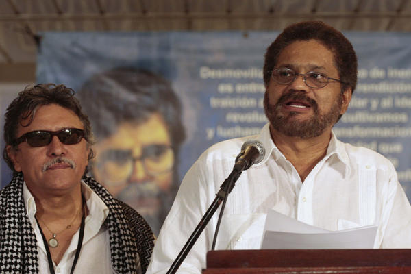 Colombia's FARC lead negotiator Ivan Marquez speaks to reporters as FARC member Jesus Santrich stands behind after a joint declaration in Havana, Cuba, November 6, 2013