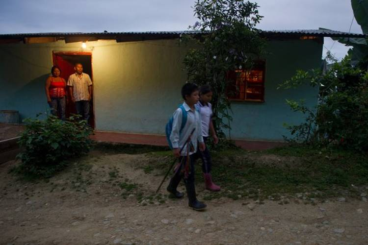Luis Robayo/Agence France-Presse - Getty Images Children in a Colombian village walking to school. Often students may miss school for months at a time while they work to contribute to a family's income or for other family reasons.