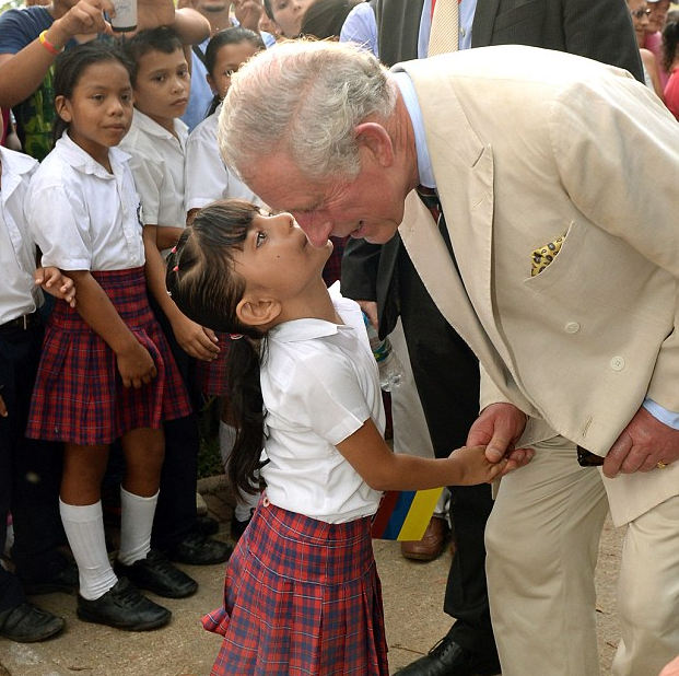 Pucker up! The Prince of Wales is kissed by a local school girl after he and the President of Colombia Juan Manuel Santos visited La Macarena Church, La Macarena in Colombia, on the third day of the Prince of Wales and Duchess of Cornwall's tour to Colombia and Mexico Read more: http://www.dailymail.co.uk/femail/article-2815472/Pucker-Prince-Charles-Royal-gets-kiss-local-schoolgirl-visit-Colombian-village.html#ixzz3HlJm71tQ Follow us: @MailOnline on Twitter | DailyMail on Facebook