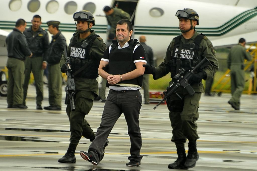 Daniel Barrera being escorted by the police in Colombia in 2013 for his extradition to the United States. Luis Acosta/Agence France-Presse — Getty Images
