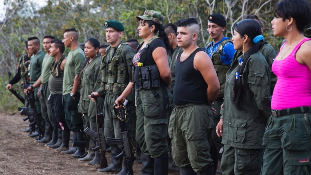 Rebels of the Revolutionary Armed Forces of Colombia, FARC, stand in formation during the group's 10th conference in the Yari Plains, Colombia, on Saturday, Sept. 17, 2016, where leaders and delegates gathered to vote on the accord reached last month with the Colombian government to end five decades of war. (Ricardo Mazalan/Associated Press)