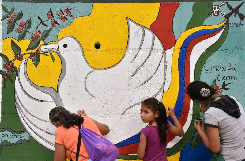 A peace mural is painted near the road leading to Planadas, Colombia, where a peasant uprising in 1964 led to the birth of the Revolutionary Armed Forces of Colombia