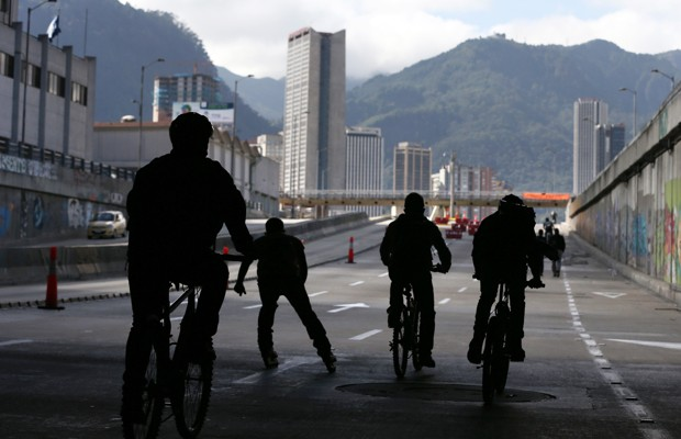 """Commuters bike to their destinations on a """"Day Without Cars and Motorcycle"""" in Bogota, Colombia. (AP Photo/Fernando Vergara)"""