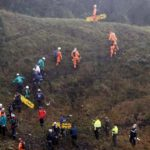 Rescue crew work near the wreckage from a plane that crashed into Colombian jungle with Brazilian soccer team Chapecoense, seen near Medellin