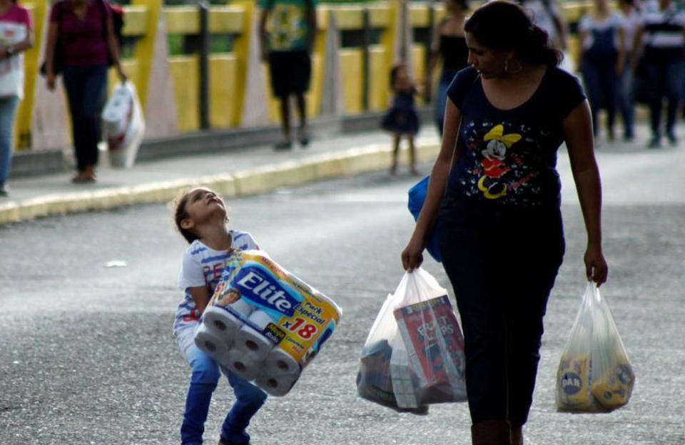 Mother and child shopping in Colombia. Around 92 percent of Venezuelans travel to Colombia for food, cleaning products and medicine, which are all scarce in their country